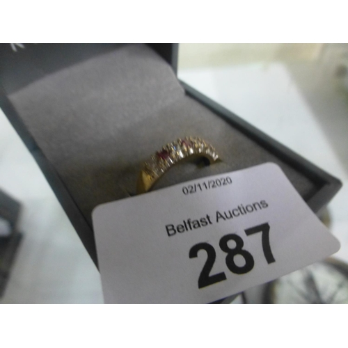 287 - 9CT GOLD RED STONE AND CZ RING (N)...