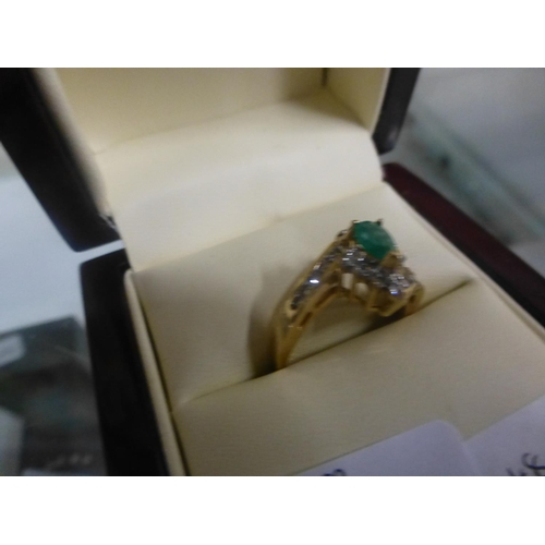 288 - 9CT GOLD GREEN STONE AND DIAMOND RING (N)...