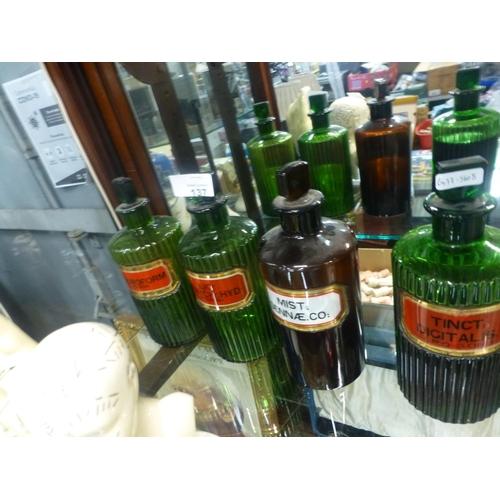 137 - 4 GREEN GLASS BOTTLES