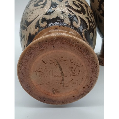 19a - A pair of R.W. Martin Brothers Early Stoneware Vases, 1884, incised and impressed stylised Cherubs a...