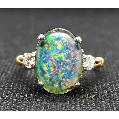 2b - A Stunning 18ct Gold, Opal and Diamond Triplet ring of approximately 4 Carats (measuring 14x10mm), t...