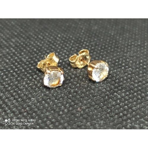2d - A pair of 9ct gold stud earrings set with white stones 1gm total weight....