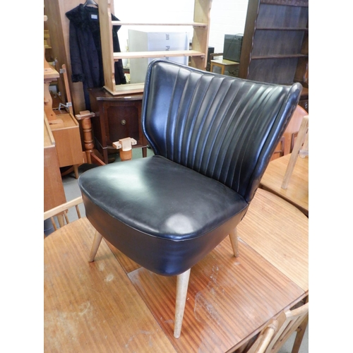 148 - A Mid Century Cocktail Chair with Black Leather Upholstery