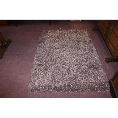 10 - 1x purple woven floor rug...
