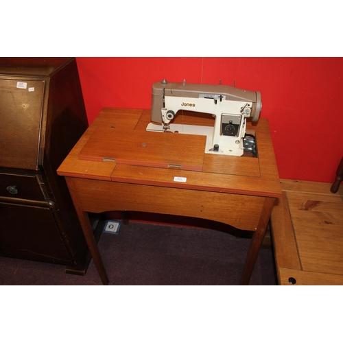 41 - 1 x teak work stand with jones sewing machine...
