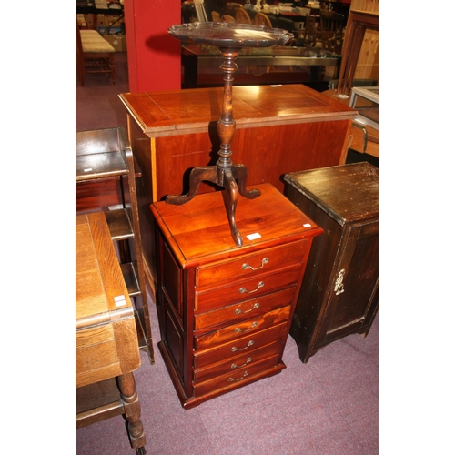 42 - 1 x wine stalk side table with mahogany 7 drawer unit...