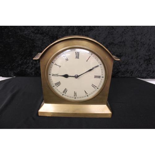 106 - 1 x large heavy brass quartz mantle clock...