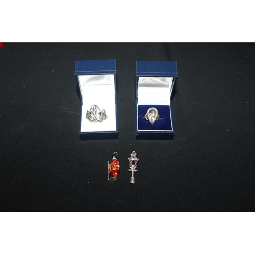 147 - 2 x silver rings with 2 x necklace pendants...