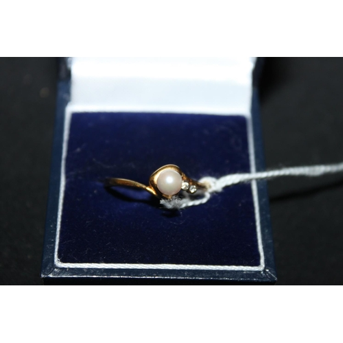 149 - 1 x 18ct gold diamond and pearl set ring...