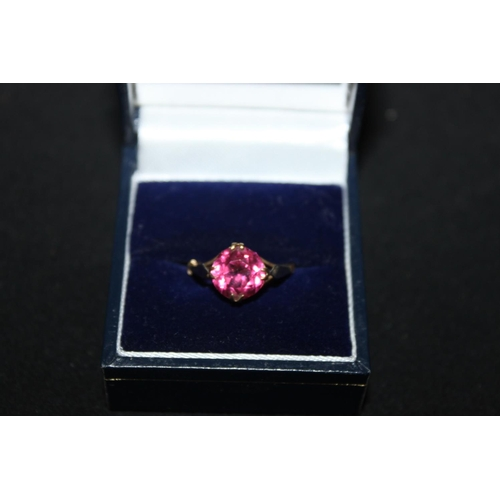 153 - 1 x 9 ct gold pink cubic zirconia  inset ring...