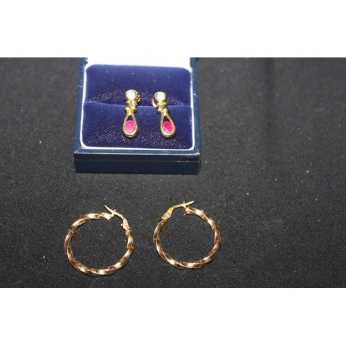 161 - 1 x pair of 9ct gold diamond and saphire inset earrings with 9ct gold hoops...