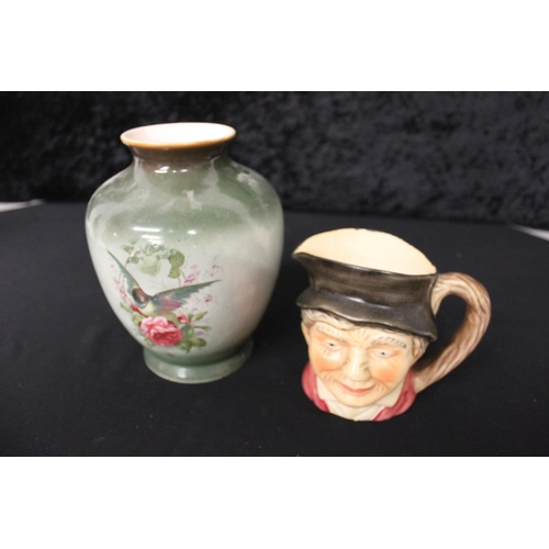 68 - 1 x small pottery toby jug with deco vase....