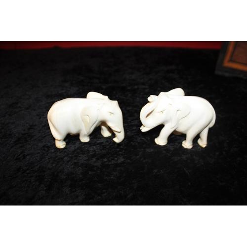 323 - 2 x ivory carved elephants...