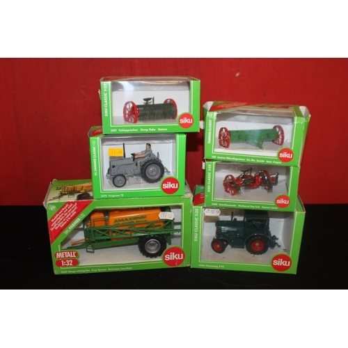 348 - 2 x siku tractors with 4 x farming attachments all boxed...