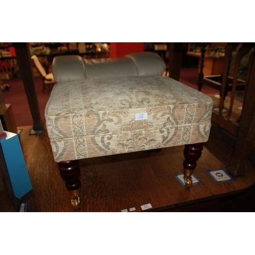 53 - 1 x cream upholstery brass caster foot stool...