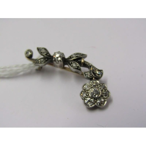 415 - DIAMOND SET BAR BROOCH, in the form a daisy with diamonds set to the head and leaves...