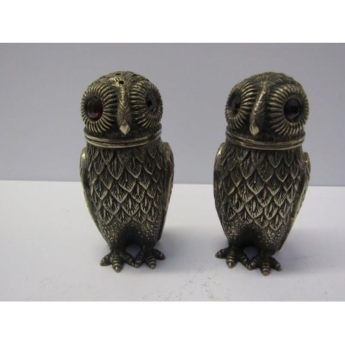 654 - NOVELTY SILVER PEPPERETTES, a pair of novelty silver salt & pepper pots in the form of owls with scr...