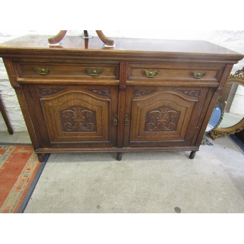 814 - EDWARDIAN SIDEBOARD, carved oak twin cupboard base sideboard with brass drop handles, 58.5