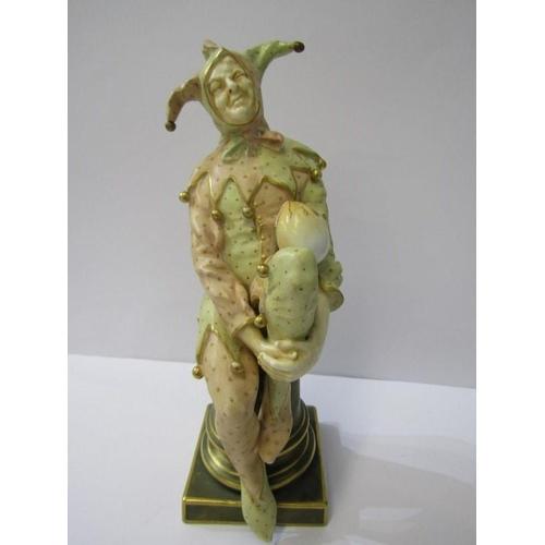 12 - DOULTON BURSLEM FIGURE, Jester resting on plinth, signed Noke, some restoration, 9.5