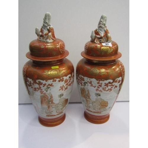 37 - ORIENTAL CERAMICS, pair of Kutani lidded vases, Sage finials decorated with geishas and garden panel...
