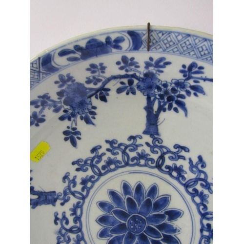 39 - ORIENTAL CERAMICS, Chinese underglaze blue saucer dish decorated with blossoming tree design and dou...
