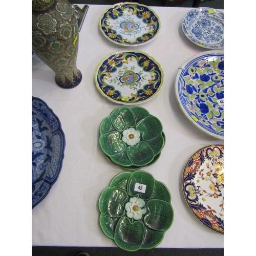 42 - MAJOLICA, 3 Majolica Lily design dessert plates; also a pair of faience dessert plates...