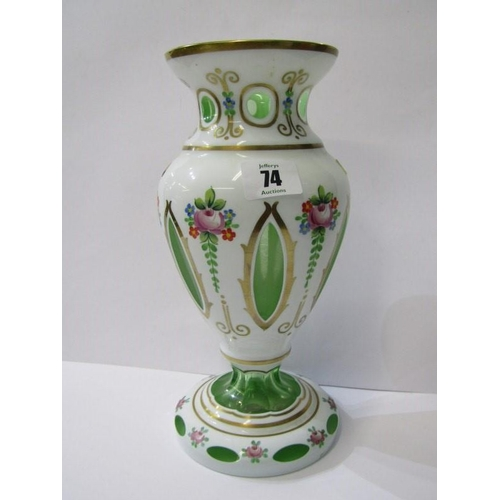 74 - VICTORIAN OVERLAY GLASS, an attractive floral painted overlay green glass vase with cut windows, 10