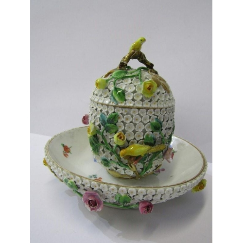 75 - MEISSEN, floral encrusted lidded cup and saucer with bird applied decoration (some faults)...
