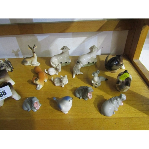 36 - RUSSIAN ANIMAL FIGURES; A collection of 24 assorted Russian animal figures including sheep, goats, d...