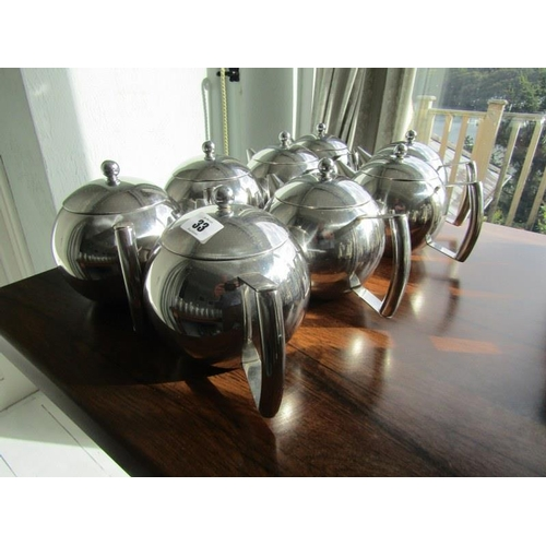 33 - 8 STAINLESS TEAPOTS...