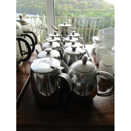 35 - 11 ASSORTED STAINLESS TEAPOTS...