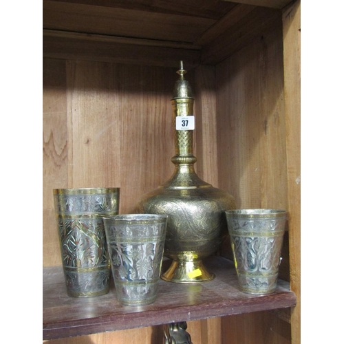 37 - EASTERN BRASSWARE, fine engraved brass decanter and 3 engraved tumblers...
