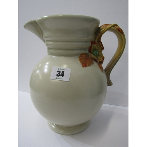 34 - CLARICE CLIFF, Celadon ground floral and foliate handled jug, pattern No. H95, 9