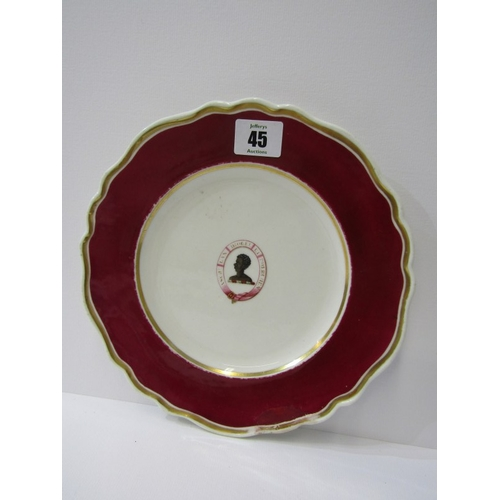 45 - CHAMBERLAINS WORCESTER, gilt and cerise edged Heraldic dinner plate, decorated with Blackamoor Head ...