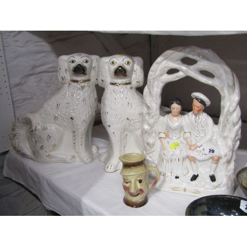 20 - STAFFORDSHIRE POTTERY, gilded pottery bower courting group; also pair gilt seated spaniels & Ally Sl...