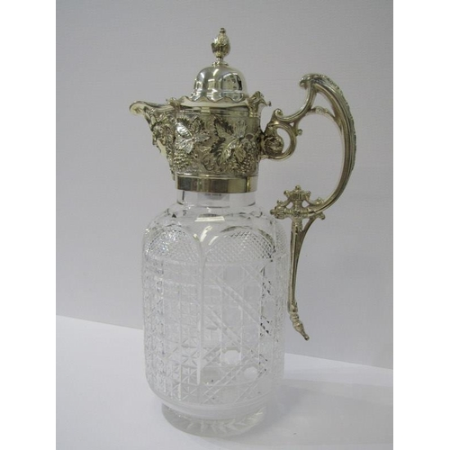 122 - CLARET JUG, a quality cut glass claret jug with silver plated vine bordered mount, 11.25