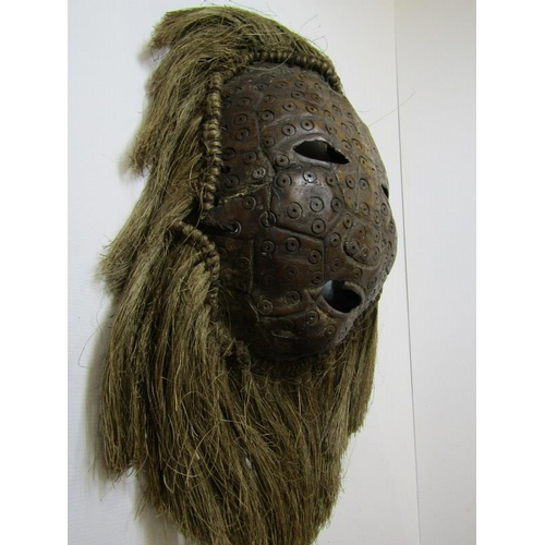 137 - ETHNIC MASK, a carved Tortoiseshell ethnic mask with rope fringe surround, possibly Ivory Coast, 7.5...