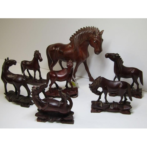 139 - ORIENTAL CARVING, a collection of 7 carved cherry root horses...