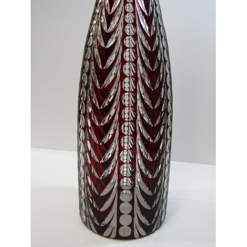 36 - CUT GLASS, a stylised ruby cased cut glass mallet shaped decanter and stopper...
