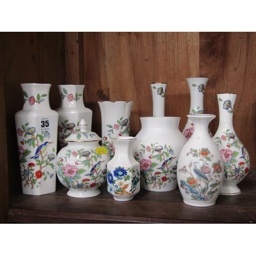 35 - AYNSLEY, collection of 10 floral decorated vases and jars...