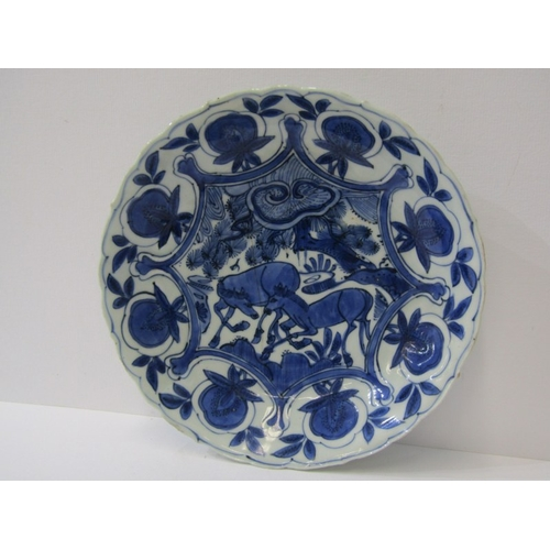26 - ORIENTAL CERAMICS, Chinese Transitional period, under-glaze blue lobed edge saucer dish, decorated w...