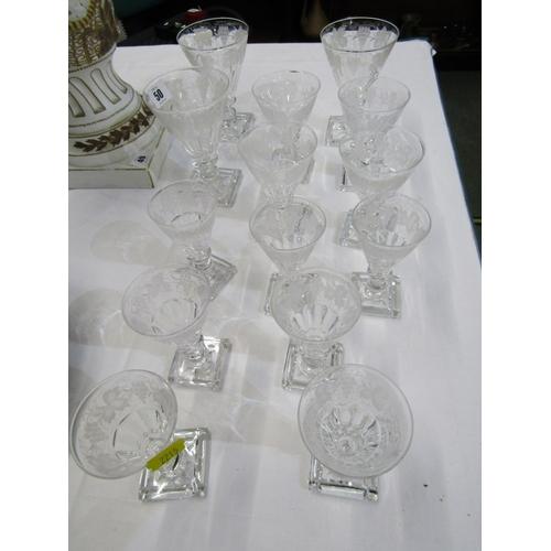 50 - CUT GLASS, Stuart vine etched border tableware of 14 graduated glasses...
