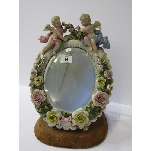 14 - THURINGIAN MIRROR, cherub crested floral encrusted oval easel mirror on early velvet stand, 11.5