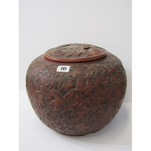 141 - EASTERN CERAMICS, terracotta spherical lidded twin handled vase with low relief decoration, 8