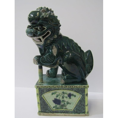 17 - ORIENTAL CERAMICS, Chinese stoneware green glazed temple dog on plinth base, 12