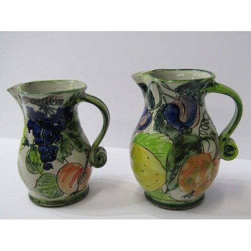 18 - STUDIO POTTERY, 2 Paul Jackson, grape and fruit decorated jugs, 6