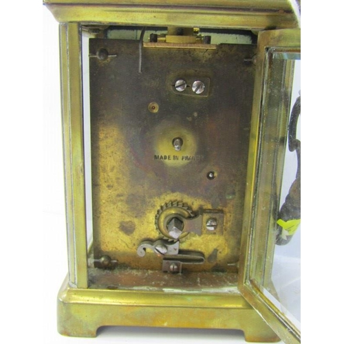 210 - CARRIAGE CLOCK, French brass cased bevelled glass carriage clock with key, together with early carry...