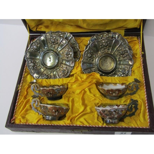 27 - ORIENTAL CERAMICS, cased set of 4 Japanese tea bowls in silver mounts and ornate floral embossed sil...