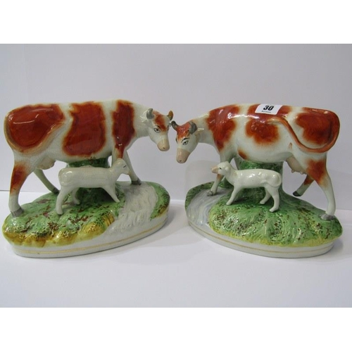 30 - STAFFORDSHIRE POTTERY, pair of 19th Century Heifer and Calf riverside figure groups (some repairs), ...