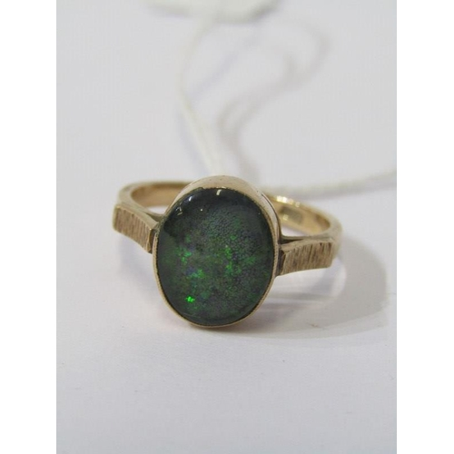 398 - OPAL RING, 9ct yellow gold ring set a large oval opal, approx 12mm dia. size Q/R...